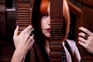 beautiful redhead woman on stairs indoor emotinal glamour
