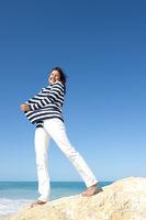 Mature woman joy ocean holiday