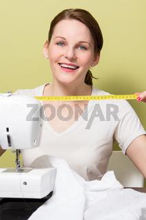 Brunette woman sewing