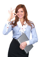 Beautiful businesswoman showing ok sign
