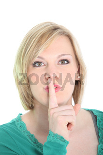 Woman requesting quiet with hushing gesture