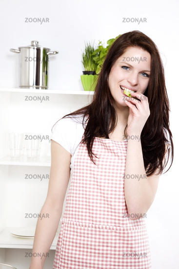 happy woman eating cucumber
