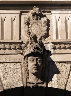 Architectural detail of a facade, face and decorated blazon
