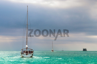Sailing boat in a azure sea
