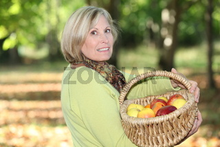 mature blonde woman in orchard