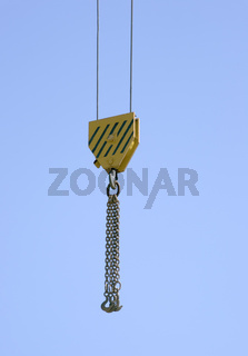 Hook of a lifting crane against clear blue sky