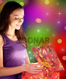 The girl opens the gift