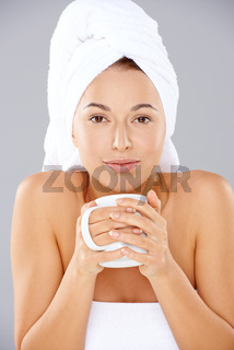Beautiful woman enjoying coffee at a spa