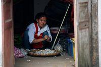 Verkäuferin in Luang Prabang