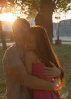 couple in backlit at sunset in park