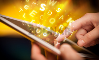 Finger pointing on tablet pc, letters concept