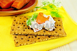 Bread with mayonnaise and salmon on board