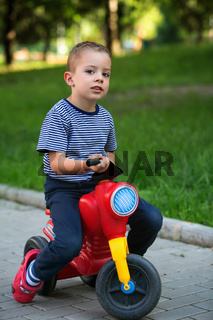 Little baby boy on bike