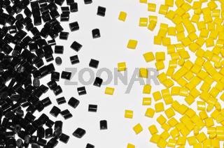 schwarz-gelbes Polymer Granulat
