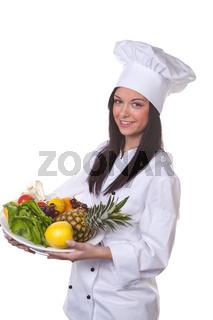 Köchin serviert ein Obst und Gemüse Schale