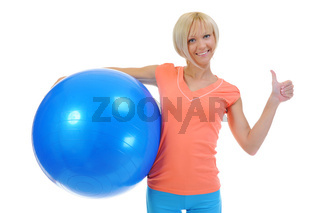 Young woman with blue ball
