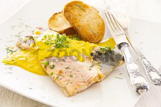 Fish fillet with saffron sauce