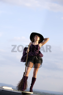 pretty witch with hat and broom