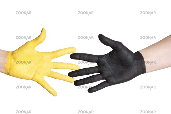 a black and a yellow painted hand in handshake gesture