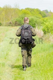 Wildlife photographer with long telephoto