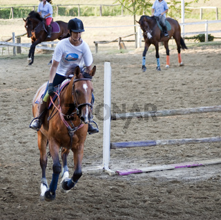 girl rides a race horse