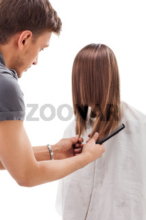 Professional hairdresser with long hair model