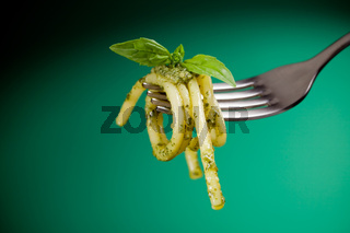 Pasta with pesto wrapped on a fork