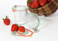 Mason jars and basket of strawberries