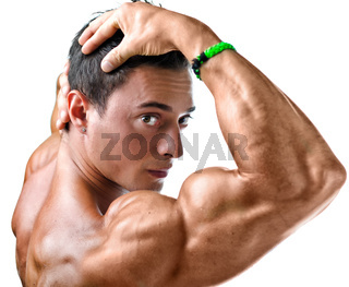 Closeup of young man with muscular arm in front of his face