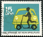 GERMANY - 1966: shows automobile and child with scooter