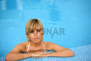beautiful fair-haired woman in swimming pool