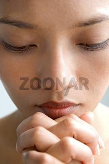 portrait of woman praying