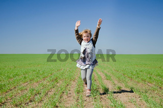 The girl runs across the field