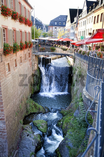 waterfalls of the Leukbach stream in the historic town centre of