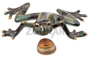 ceramic frog and coins isolated on white