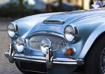 A classic shiny metallic blue sports car