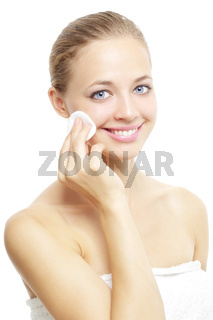 Beautiful girl with cotton pad on white