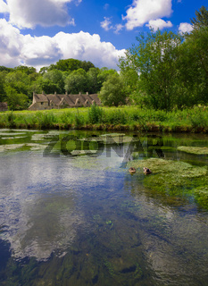 Arlington Row in Bibury with River Coln, Cotswolds, Gloucestershire, UK