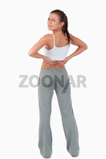 Back view of woman with backache