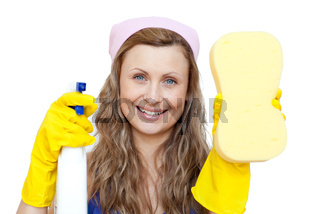 Cheerful woman holding a sponge and a detergent spray