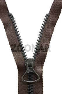 Unzipped black metal zipper on white background