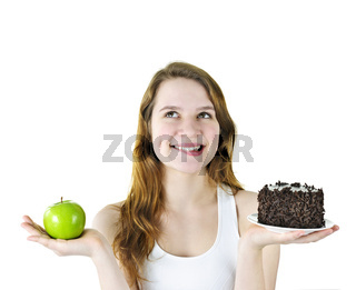 Young girl holding apple and cake