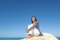 Relaxed mature woman ocean background