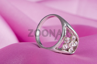 Jewellery ring on the satin background