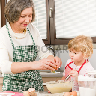 Grandmother and granddaughter baking cookies