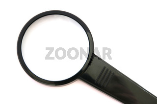 Black loupe magnifying glass on white background