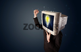 Business man with a pc monitor head and idea light bulb in the display