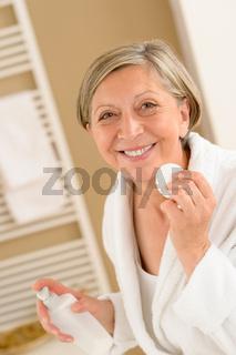Senior woman hold cotton pad make-up removal