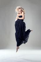 Beautiful blonde dancer posing in jump
