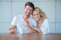 Affectionate couple enjoying a morning coffee